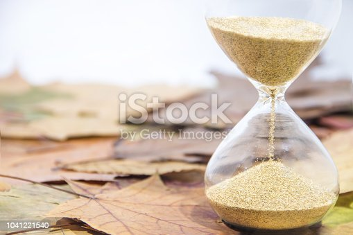 607492948 istock photo Daylight Saving Time. Wall Clock going to winter time. Autumn abstraction. 1041221540