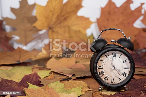 istock Daylight Saving Time. Wall Clock going to winter time. Autumn abstraction. 1054106252