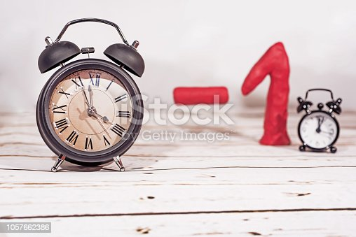 istock Daylight Saving Time. Wall Clock going to winter time. Autumn abstraction. 1057662386