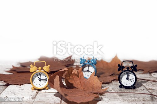 istock Daylight Saving Time. Wall Clock going to winter time. Autumn abstraction. 1057662546