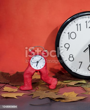 istock Daylight Saving Time. Wall Clock going to winter time. Fall back time 1048955694