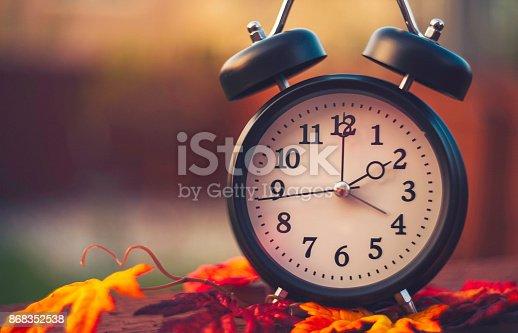 istock Daylight savings time clocks fall back in Autumn 868352538