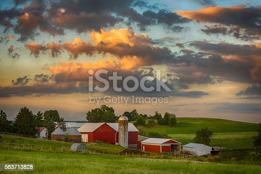 Sunset on a traditional dairy farm in rural Ohio in July