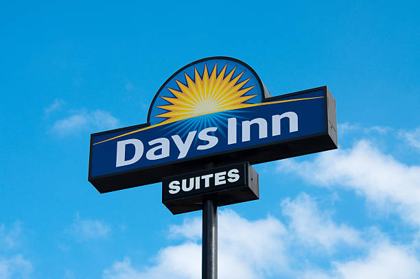 Days Inn Outdoor Sign Tuscaloosa, Alabama, USA - February 25, 2011: A roadside sign for a Days Inn, near the business location. inn stock pictures, royalty-free photos & images