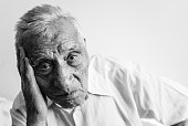 An old man with wrinkles close up. Black and white photo.