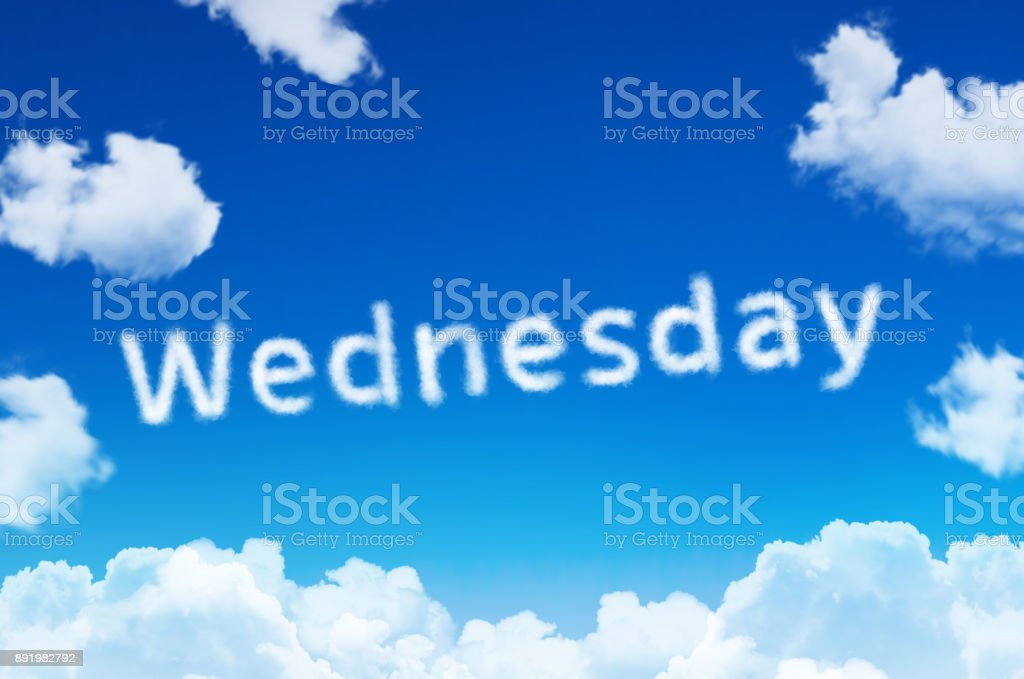 Days of the week - wednesday cloud word with a blue sky. stock photo