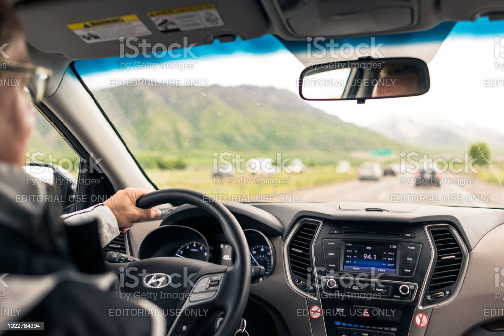 Daytime freeway driving through the country stock photo
