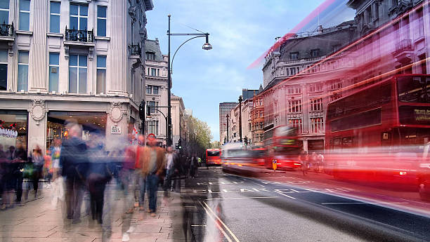 Daytime Long Exposure on Oxford Street Daytime long exposure on Oxford Street near Oxford Circus on a busy weekend afternoon as shoppers walk past and several buses drive by. long exposure stock pictures, royalty-free photos & images