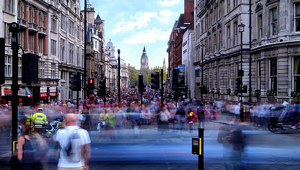 daytime long exposure towards whitehall - people uk stock photos and pictures