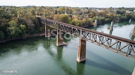 Scenic Daytime Aerial Drone Outdoor Photography Vintage Rust Covered Old Steel Railroad Train Track Crossing Historic Potomac River in Maryland, USA