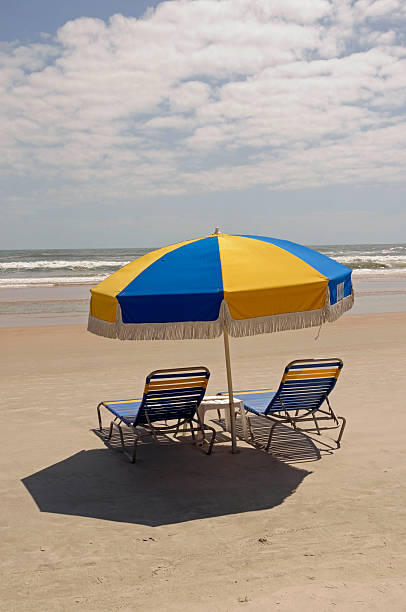 Daytona Beach Umbrella and Chair by the Ocean stock photo
