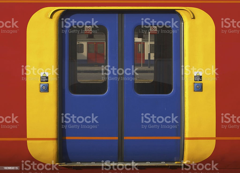 Brightly colored doors on an overground train stock photo