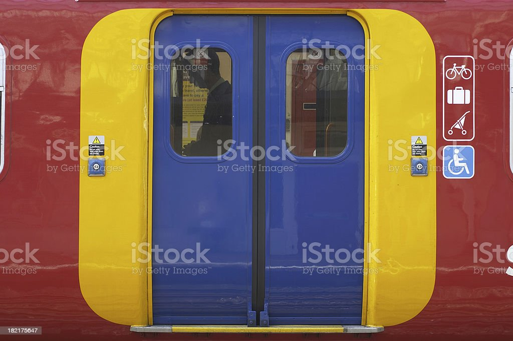 Access via brightly colored doors on an overground train stock photo