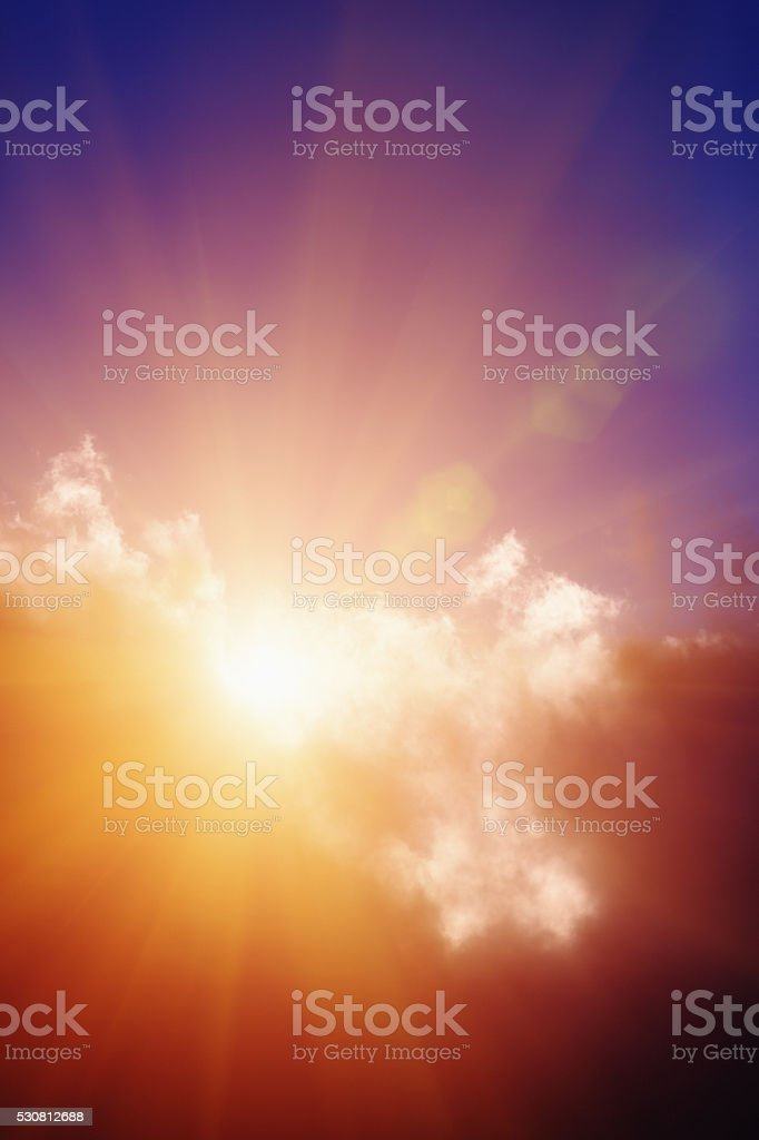 Dazzling sun breaking through cloud cover stock photo