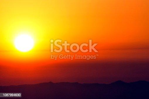 Dazzling sun in a golden sky