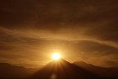 Dazzling Sun Rising on the Peak of Licancabur Volcano as Seen from the Town of San Pedro de Atacama in Northern Chile