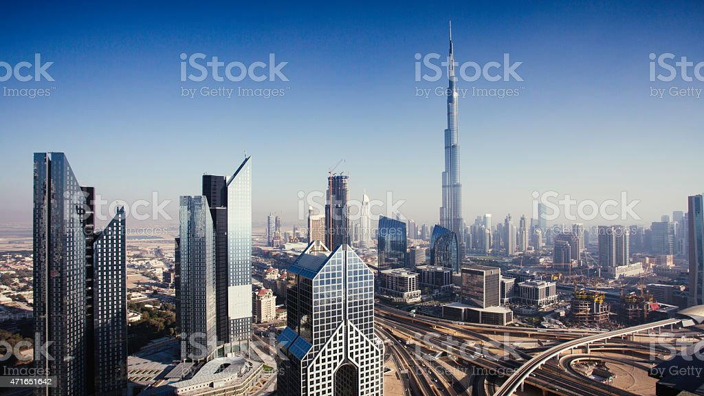 Dbuai sky line with traffic junction and Burj Khalifa stock photo