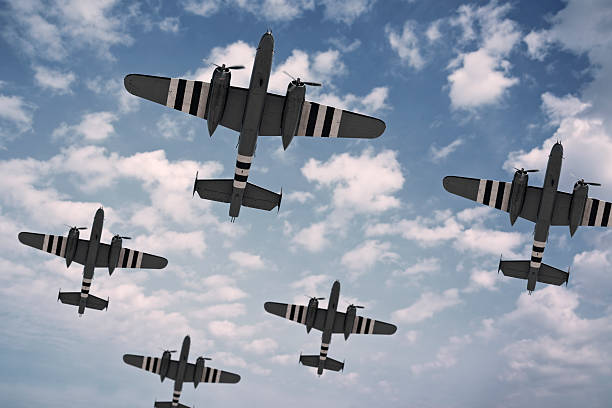 D-Day Dawn A formation of five North American B-25 Mitchells, painted with D-Day invasion stripes.. bomber plane stock pictures, royalty-free photos & images
