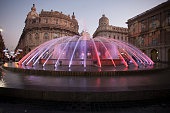 Genoa, Italy - January 5, 2020: De ferrari fountain at night. Its famous fountain in the middle of the square is one of the most beautiful of Italy