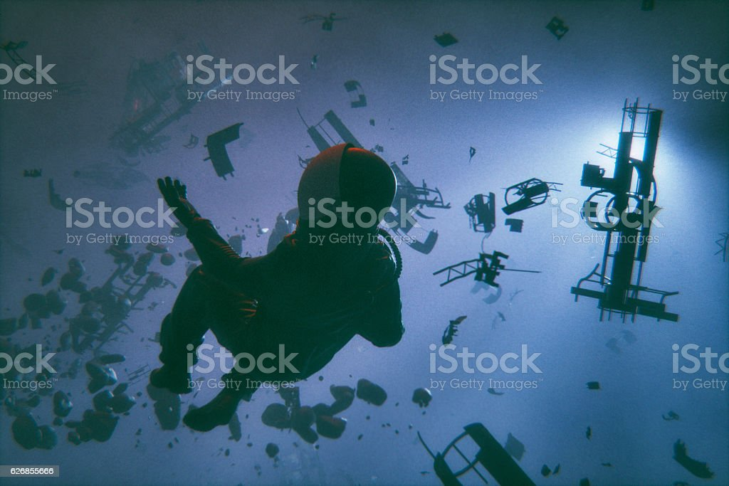 Dead astronaut in space stock photo
