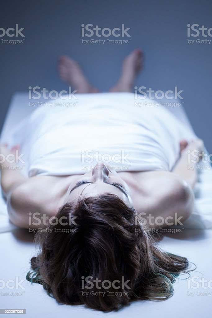 Dead body of woman stock photo