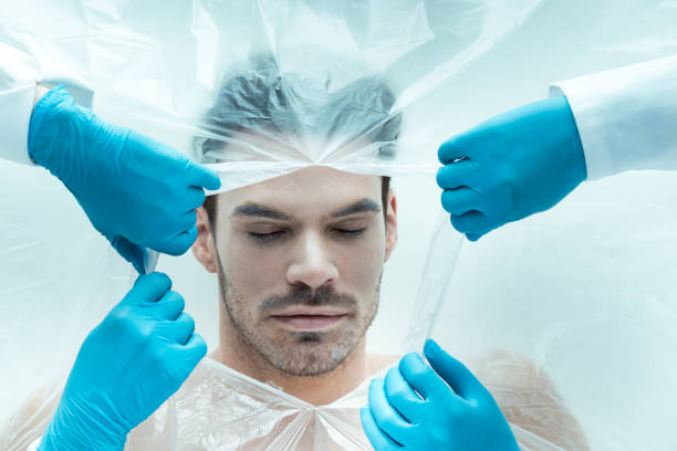 Dead body Man in body bag. Halloween theme. cryotherapy stock pictures, royalty-free photos & images