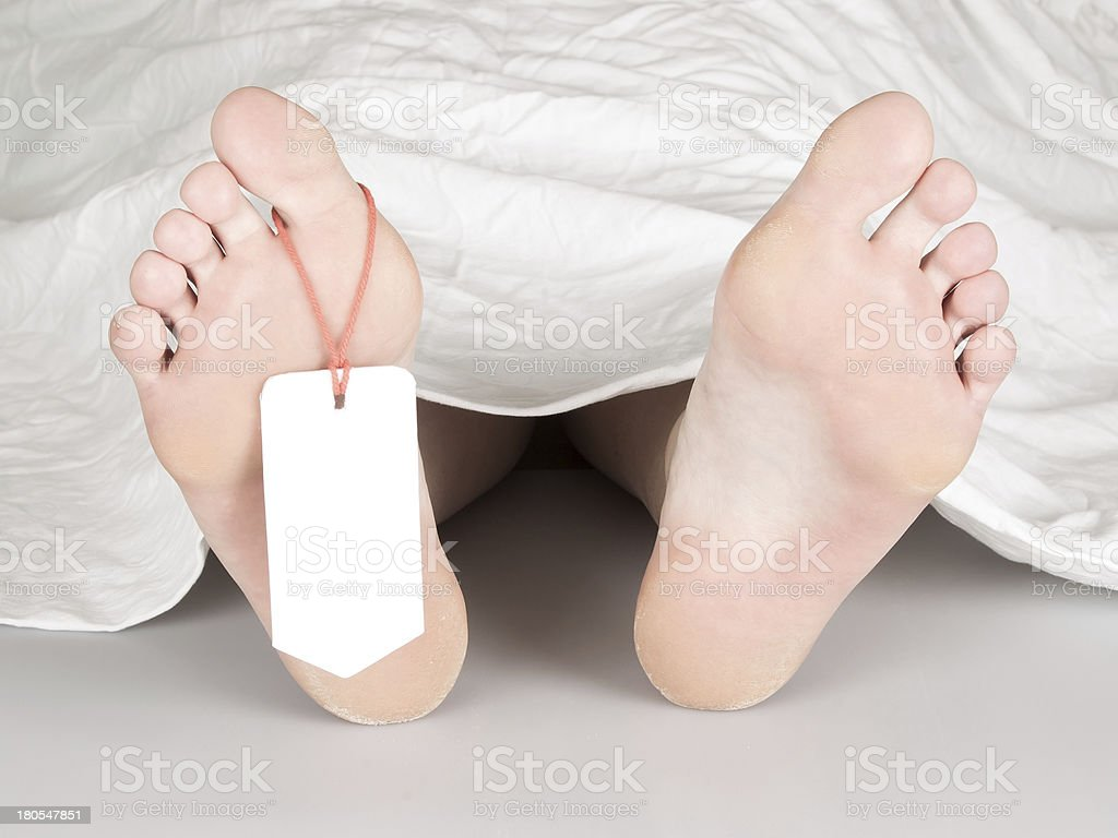 Dead body with toe tag stock photo