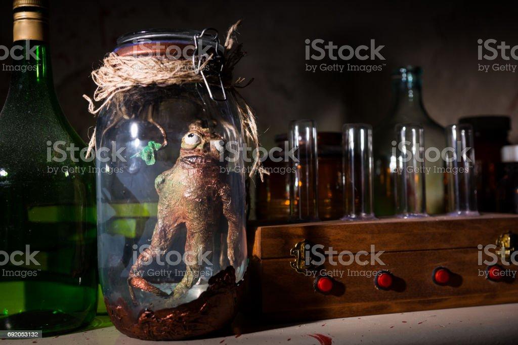 Dead creature inside mason jar stock photo