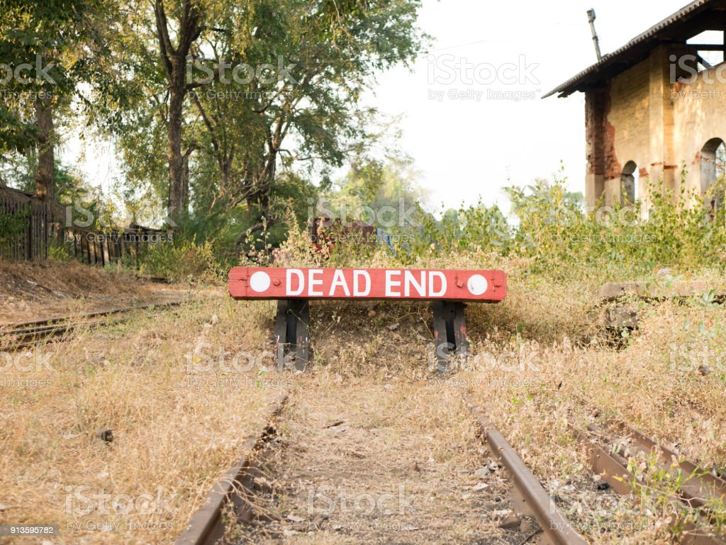 Dead end sign at a train station stock photo