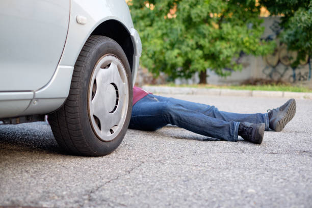 Dead pedestrian after a car accident Dead pedestrian after a car accident knocked down stock pictures, royalty-free photos & images
