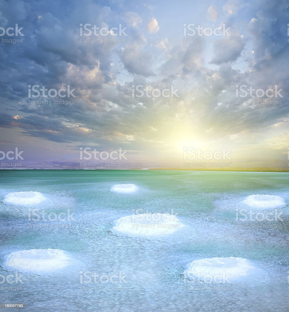 Dead Sea and salt little islands. Healthy lake with sunset. royalty-free stock photo