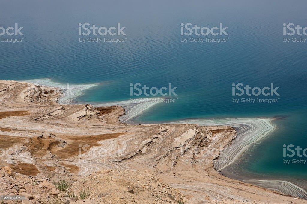 Dead Sea in Jordan salt deposits on shore stock photo