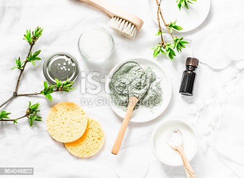 Dead sea mud mask - beauty products ingredients on light background, top view. Beauty concept. Flat lay