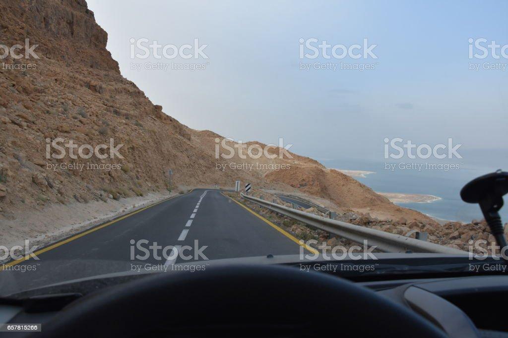 Winding desert road to the Dead Sea