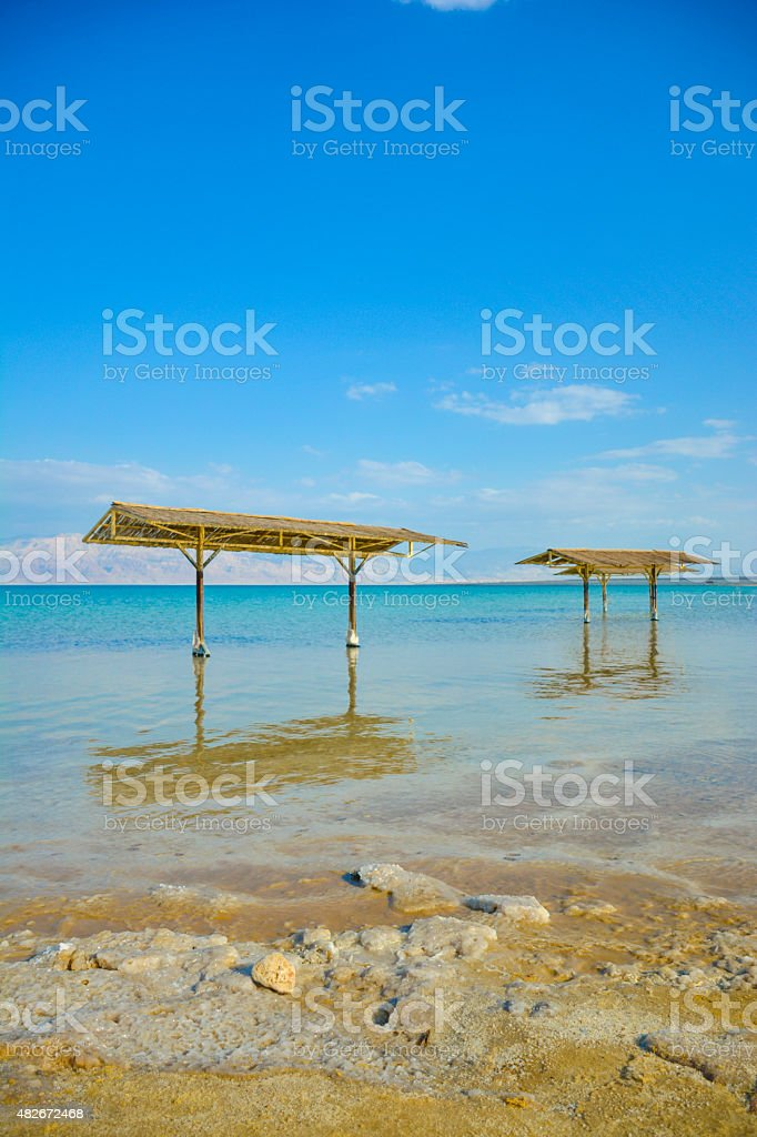 Dead Sea thatch roof stock photo