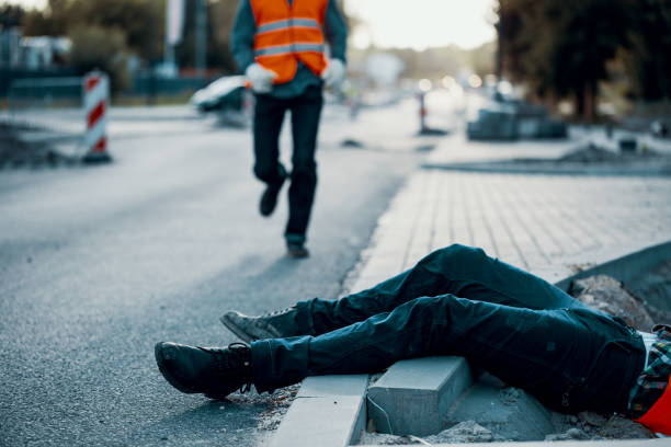 Dead victim during roadworks. Non-compliance with health and safety regulations stock photo