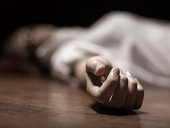 Dead woman's body with focus on hand