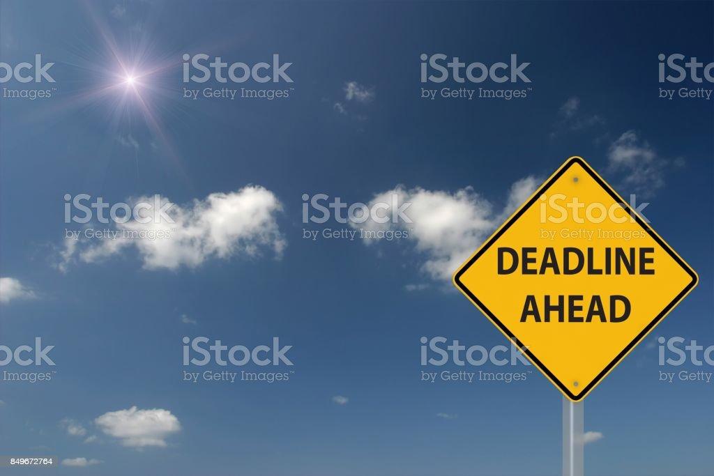 Deadline ahead warning sign concept stock photo