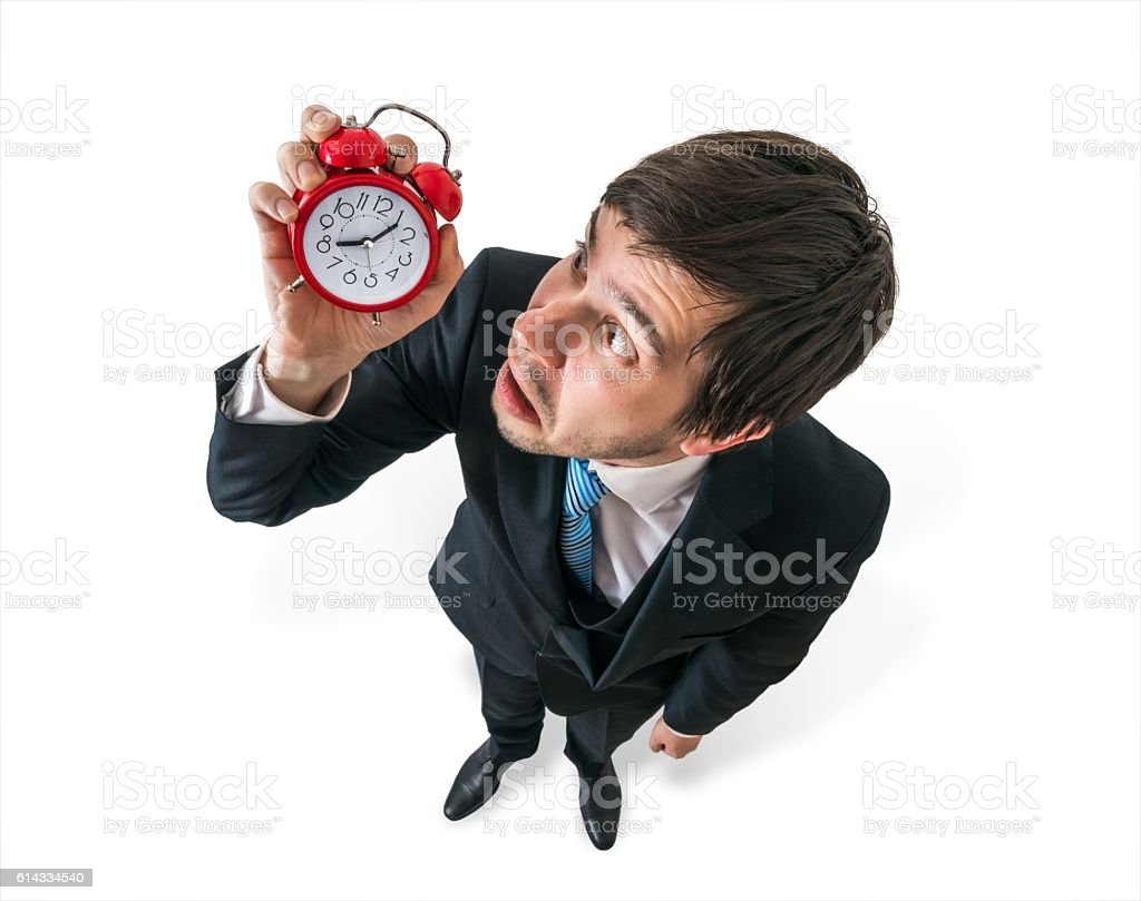 deadline concept young stressed businessman is looking at clock