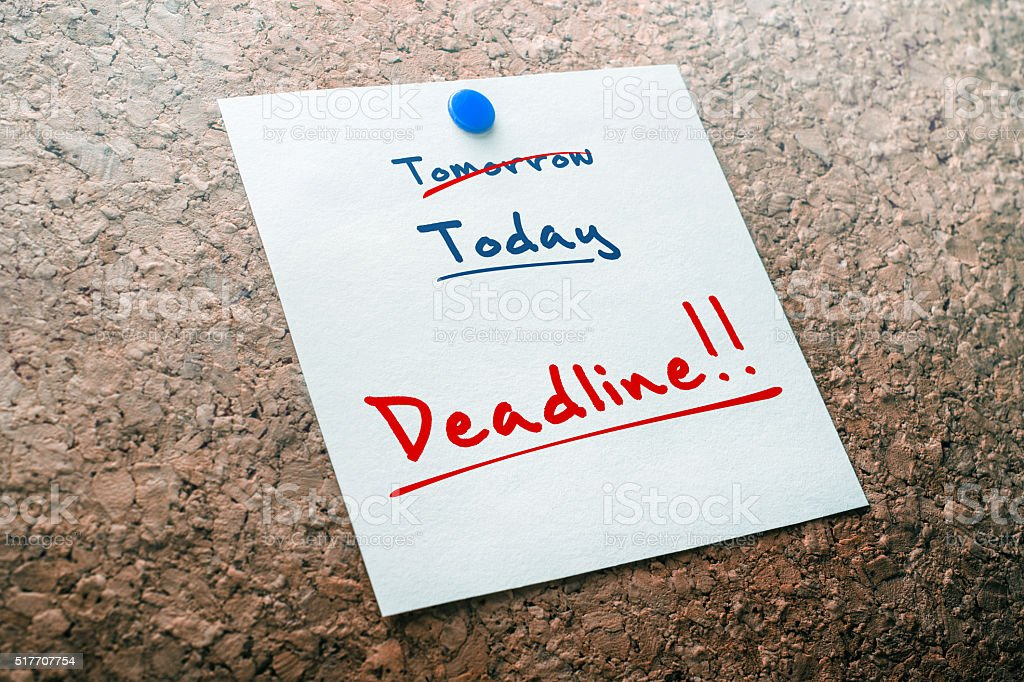 Deadline Reminder For Today With Crossed Out Tomorrow On Paper stock photo