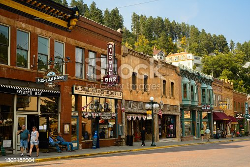 Deadwood, SD, USA - September 15, 2020: Historic saloons, bars, and other attractions bring visitors to Main St. in this Black Hills gold rush town, famous for Wild Bill Hickok and Calamity Jane.