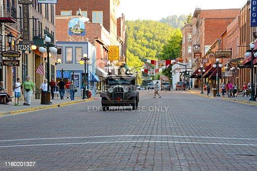 Deadwood, South Dakota, 07/10/2013 vintage car approaching on main street in Deadwood