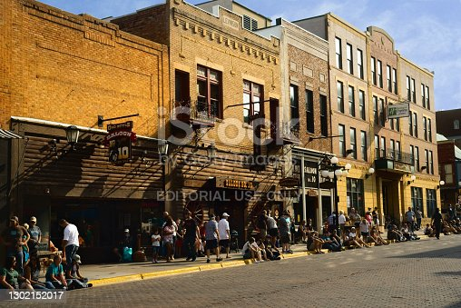 Deadwood, SD, USA - September 15, 2020: Even during the Covid pandemic, visitors line up for dinner outside Saloon No. 10 on historic Main St. in this Black Hills gold rush town.