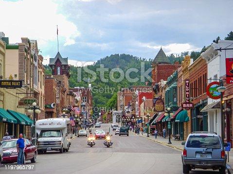 Tourists and visitors amble through the main tourist district of Deadwood, South Dakota.