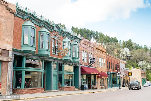 Deadwood, United States - May 8, 2016: Historic buildings in this Western South Dakota town remain active with a variety of retail businesses. Few cars drive along the quiet streets.