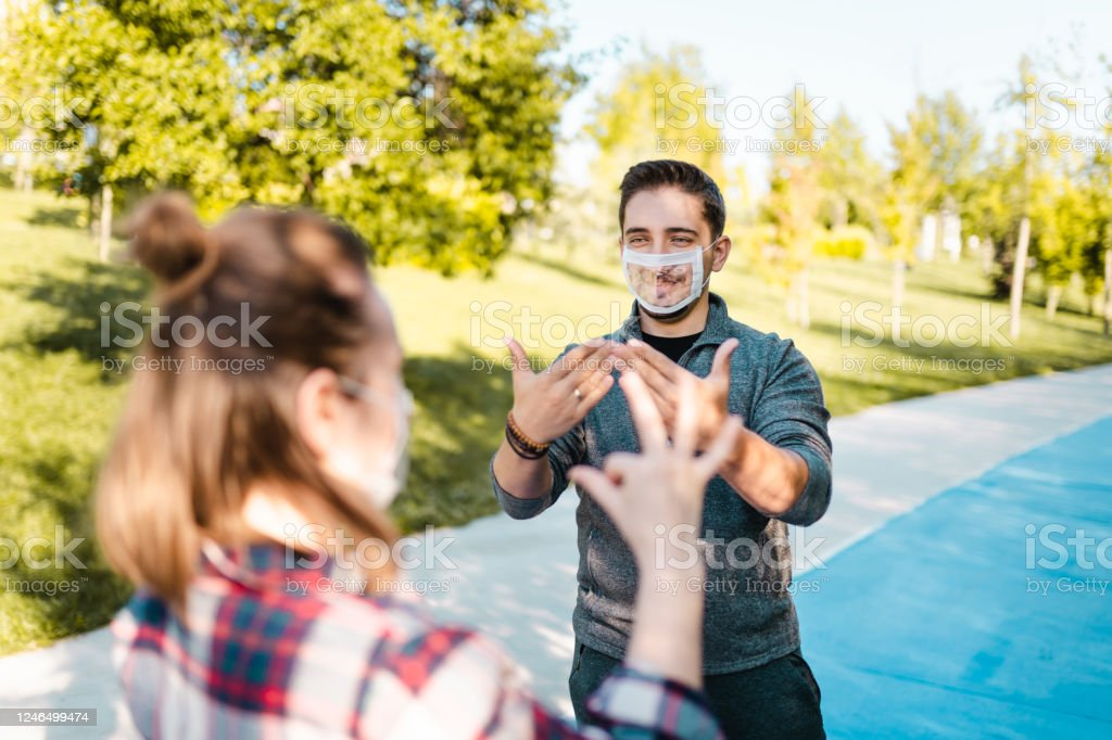 Deaf and hard hearing Young Adults wearing special face mask for lip-reading - Royalty-free Accessibility for Persons with Disabilities Stock Photo