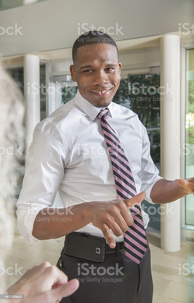 Deaf Businessman talking with business partner stock photo