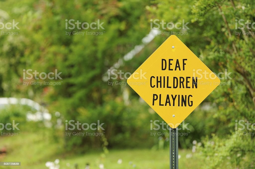 Road sign deaf children playing.