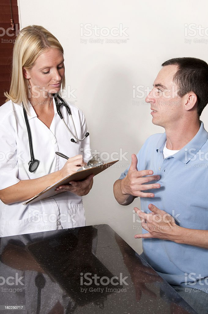 Deaf man signing to a Nurse stock photo