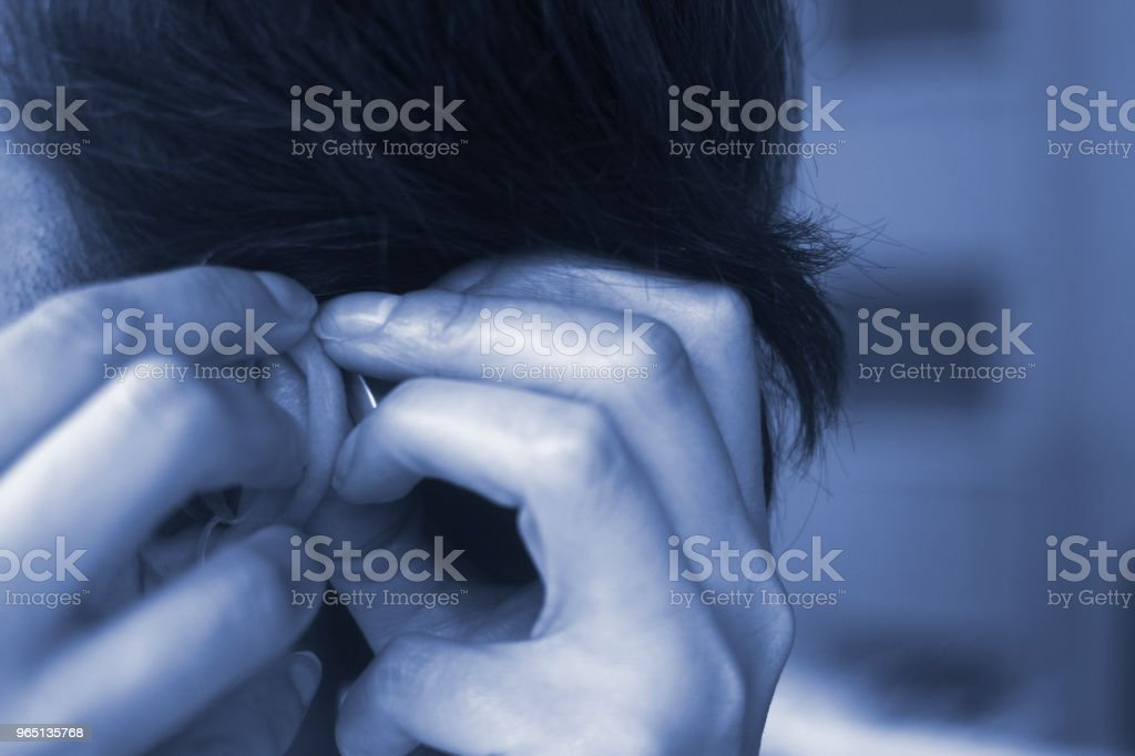 Deaf middle aged lady wearing modern digital high technology hearing aid in ear. royalty-free stock photo